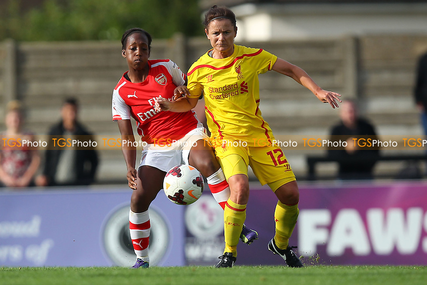 Danielle Carter of Arsenal Ladies and Becky Easton of Liverpool Ladies - Arsenal Ladies vs Liverpool Ladies - FA Womens Super League Football at Meadow Park, Boreham Wood FC  - 05/10/14 - MANDATORY CREDIT: Gavin Ellis/TGSPHOTO - Self billing applies where appropriate - contact@tgsphoto.co.uk - NO UNPAID USE