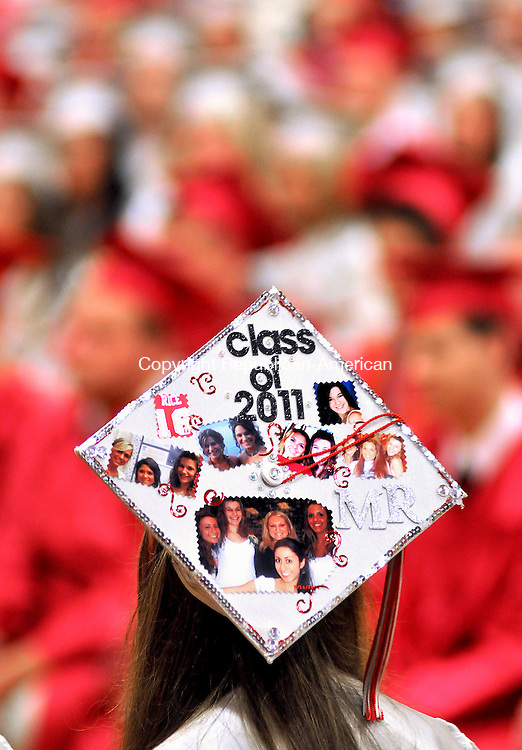 WOLCOTT, CT, 22 JUNE 2011-062211JS04--Wolcott High School graduate Megan Rice, with her hat adorned with photos of friends, waits for her name to be called to receive her diploma during graduation ceremonies Wednesday at Wolcott High School. <br /> Jim Shannon/Republican-American