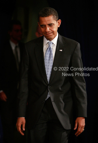 Chicago, IL - December 18, 2008 -- United States President-elect Barack Obama leaves the stage after introducing Mary Schapiro, CEO of the Financial Industry Regulatory Authority (FINRA), as his choice to head the U.S. Securities and Exchange Commission (SEC), Gary Gensler, as head the Commodities Futures Trading Commission (CFTC), and Daniel Tarullo to the Federal Reserve Board of Governors during a press conference at the Drake Hotel December 18, 2008 in Chicago, Illinois. .Credit: Scott Olson - Pool via CNP
