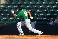 Joe Tuschak (22) of the Savannah Sand Gnats follows through on his swing against the Hickory Crawdads at L.P. Frans Stadium on June 14, 2015 in Hickory, North Carolina.  The Crawdads defeated the Sand Gnats 8-1.  (Brian Westerholt/Four Seam Images)