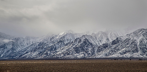 The snow-covered Sierra Nevada Mountains are the predominate feature at Owens Valley, California