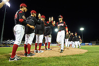 Batavia Muckdogs Eric Fisher (29) goes through the high five line after a win against the Mahoning Valley Scrappers on July 3, 2015 at Dwyer Stadium in Batavia, New York.  Batavia defeated Mahoning Valley 7-4.  (Mike Janes/Four Seam Images)