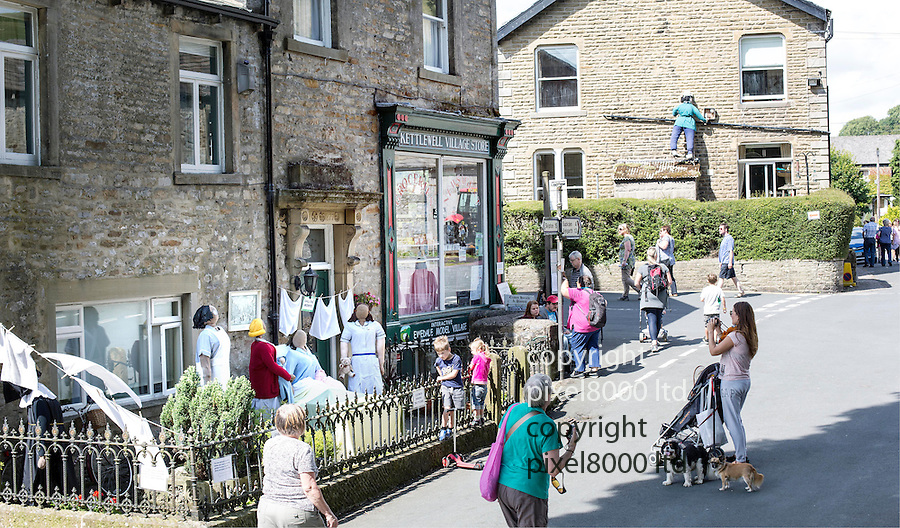 Scarecrow Festival at Kettlewell in Yorkshire 2013<br /> <br /> Call the Midwife group outside Kettlewell Village Store<br /> <br /> <br /> Scarecrows are made by local community and places in and around their front gardens.  Competition is fierce but it's all to raise money  for the local church  and other local projects to benefit the whole community.<br /> <br /> <br /> <br /> Picture by Gavin Rodgers/ Pixel 8000 <br /> <br /> 07917221968