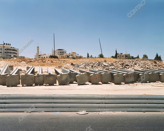 Wall sections awaiting erection, Ar Ram, West Bank, Israel, July 2004