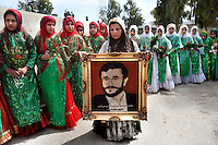 Female Shirazi supporters of the Iranian President Mahmoud Ahmadinejad wait to greet him with the gift of a framed embroidered portrait.