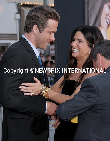 "SANDRA BULLOCK AND RYAN REYNOLDS.attends the World Premiere of ""The Change-Up"" at the Village Theatre, Westwood, Los Angeles_01/08/2011.Mandatory Photo Credit: ©Crosby/Newspix International. .**ALL FEES PAYABLE TO: ""NEWSPIX INTERNATIONAL""**..PHOTO CREDIT MANDATORY!!: NEWSPIX INTERNATIONAL(Failure to credit will incur a surcharge of 100% of reproduction fees).IMMEDIATE CONFIRMATION OF USAGE REQUIRED:.Newspix International, 31 Chinnery Hill, Bishop's Stortford, ENGLAND CM23 3PS.Tel:+441279 324672  ; Fax: +441279656877.Mobile:  0777568 1153.e-mail: info@newspixinternational.co.uk"