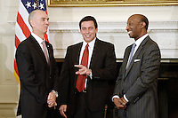 Juan Luciano (L) Chairman/President/CEO at Archer-Daniels-Midland Co, Kenneth Frazier (R) Chairman and CEO, of Merck  and Ford Motor CEO Mark Fields(C) smile during a  listening session with manufacturing CEOs  in the State Dining Room  of the White House on February 23, 2017 in Washington, DC. Photo Credit: Olivier Douliery/CNP/AdMedia
