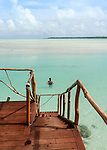 Relaxing in lagoon from over-water bungalow in Aitutaki, Cook Islands