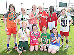 Tullyallen Girls pictured with their medals and cup after winning in the Albion Rovers Soccer Blitz. Photo:Colin Bell/pressphotos.ie