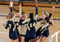 Florida International University women's volleyball players celebrate during the game against Western Kentucky University.  Western Kentucky won the match 3-0 on September 30, 2011 at Miami, Florida. .