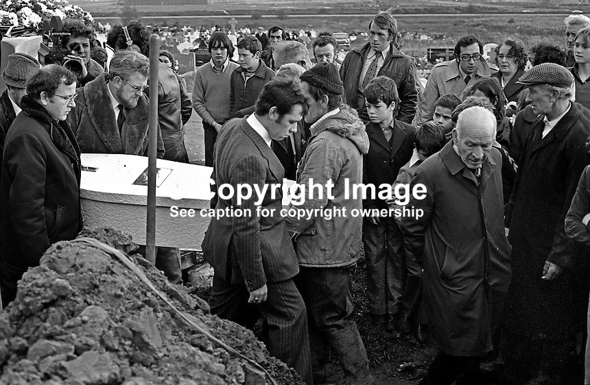 The little white coffin of Eileen Kelly, 6 years, arrives at the graveside in Milltown Cemetery. Her father is side on to the camera and wearing a pin-striped suit. Eileen died, 30th October 1975, in a Provisional IRA gun atttack targeting her father who was described as a Republican Clubs sympathiser. The Republican Clubs organization is the political wing of the Official IRA. The funeral was on 3rd November 1975. 197511030711a..Copyright Image from Victor Patterson, 54 Dorchester Park, Belfast, United Kingdom, UK...For my Terms and Conditions of Use go to http://www.victorpatterson.com/Victor_Patterson/Terms_%26_Conditions.html