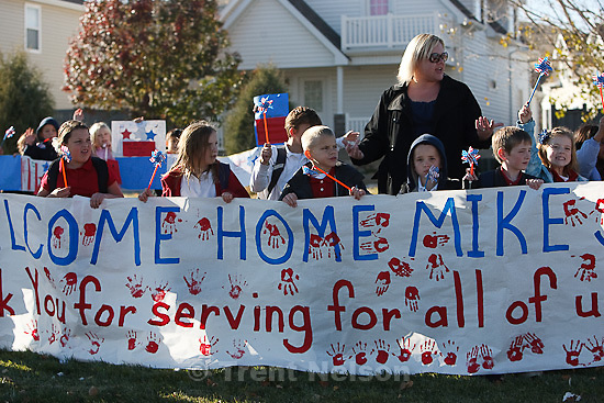 Trent Nelson  |  The Salt Lake Tribune.SFC Mike Jones, Utah National Guard, was welcomed home to Eagle Mountain by family, friends and neighbors who lined the streets of Eagle Mountain Friday, November 12, 2010. On his fourth deployment, Jones was injured in Afghanistan in September.