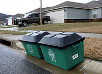 City of Fayetteville recycling bins are visible Thursday, March 19, 2020, in the Park Meadows area of Fayetteville. The city of Fayetteville is suspending it's curbside recycling program to help limit community spread of COVID-19. This suspension begins Monday, March 23, and will remain in place until further notice. All residential yard waste compost collection and residential/small commercial trash collection services will remain unchanged at this time. Check out nwaonline.com/200320Daily/ and nwadg.com/photos for a photo gallery.<br /> (NWA Democrat-Gazette/David Gottschalk)