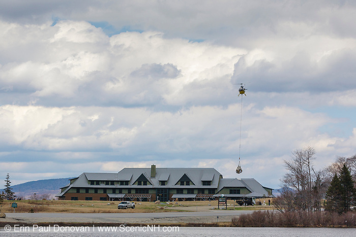Helicopter airlifting supplies from the Appalachian Mountain Club's Highland Center in Carroll, New Hampshire. The Highland Center occupies the site of the historic Crawford House.
