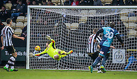 Goalkeeper Adam Collin of Notts Co can only watch as Adebayo Akinfenwa of Wycombe Wanderers scores his goal during the Sky Bet League 2 match between Notts County and Wycombe Wanderers at Meadow Lane, Nottingham, England on 10 December 2016. Photo by Andy Rowland.