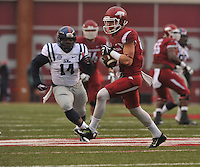 NWA Media/Michael Woods --11/22/2014-- w @NWAMICHAELW...University of Arkansas receiver Drew Morgan tries to get past Ole Miss defender Serderius Bryant after a reception in the 1st quarter of Arkansas 30-0 win over Ole Miss during Saturdays game at Razorback Stadium.