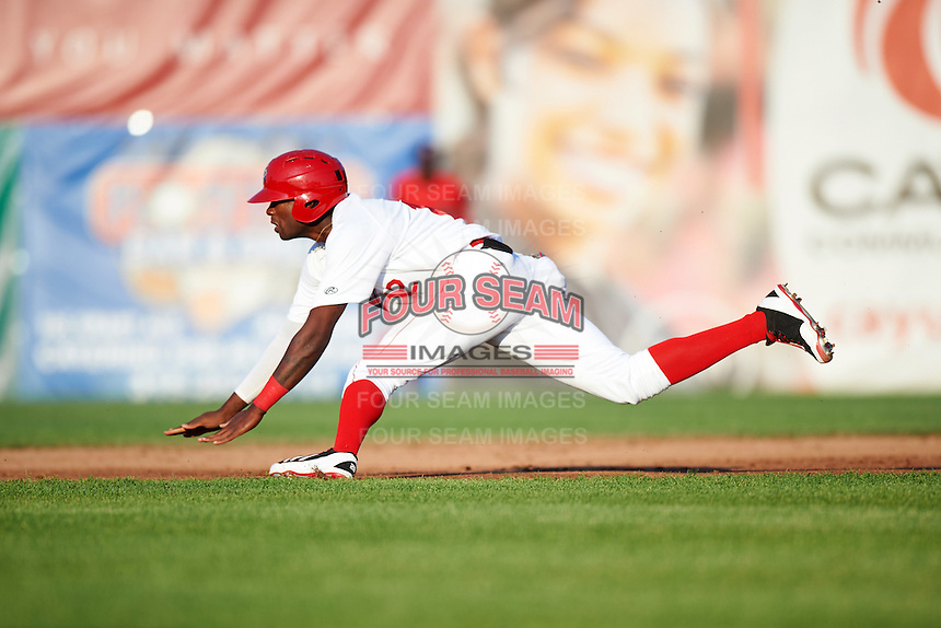 Auburn Doubledays right fielder Randy Encarnacion (12) slides into second during a game against the Williamsport Crosscutters on June 25, 2016 at Falcon Park in Auburn, New York.  Auburn defeated Williamsport 5-4.  (Mike Janes/Four Seam Images)