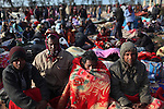 Bangladeshi men bundle up against the chill on the Tunisian side of the Ras Jidir border crossing with Libya, March 3, 2011. More than half of the 180,000 people estimated to have fled Libya have crossed into Tunisia. Thousands of Egyptian, Bangladeshi and Sri Lankan migrant workers are stuck at the border as aid organizations and governments struggle to get them home via an airlift operation. Meanwhile, many refugees have been sleeping outside on the ground, in some cases for four or more days.