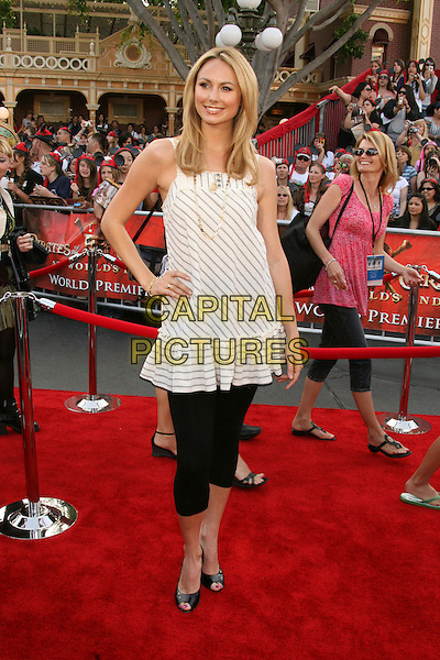 "STACY KEIBLER.""Pirates Of The Caribbean: At World's End"" World Premiere held at Disneyland, Anaheim, California, USA,.May 19th, 007.3 full length stacey kiebler white and grey striped tunic dress hand on hip over cropped black leggings.CAP/ADM/RE.©Russ Elliot/AdMedia/Capital Pictures"