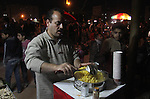 A Palestinian vendor sells corn at al-Saraya square during the preparations for the ceremony of the 48th anniversary of the founding of Fatah movement in Gaza city, on January 3, 2012. The anniversary commemorates the first operation against Israel claimed by its armed wing then known as Al-Assifa (The Thunderstorm in Arabic) on January 1, 1965. Photo by Ezz al-Zanoon
