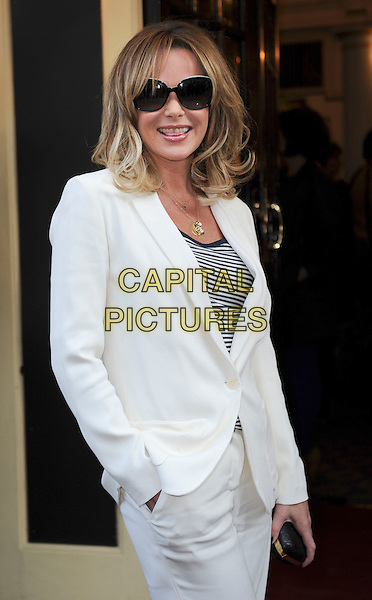 Amanda Holden.'Merrily We Roll Along' Press Night at the Harold Pinter Theatre, London, England..May 1st 2013.half length white suit sunglasses shades black gold necklace stripe top hand in pocket tongue.CAP/GM/PP.©Gary Mitchell/PP/Capital Pictures.