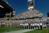Sep 25, 2005; Seattle, WA, USA; US Military personnel salute during the playing of the national anthem during military appreciation day at the Seattle Seahawks against the Arizona Cardinals at Qwest Field. Mandatory Credit: Photo By Mark J. Rebilas