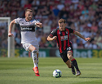 Bournemouth's Ryan Fraser (right) under pressure from  Fulham's Calum Chambers (left) <br /> <br /> Photographer David Horton/CameraSport<br /> <br /> The Premier League - Bournemouth v Fulham - Saturday 20th April 2019 - Vitality Stadium - Bournemouth<br /> <br /> World Copyright © 2019 CameraSport. All rights reserved. 43 Linden Ave. Countesthorpe. Leicester. England. LE8 5PG - Tel: +44 (0) 116 277 4147 - admin@camerasport.com - www.camerasport.com