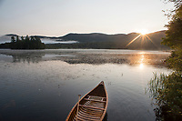 Sunrise canoeing on Lefferts Pond in Chittenden, Vermont.