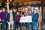 Presentation: David Geary, second from right, Chairman Ballylongford Race Committee presenting a cheque for €1500.00, the proceeds of the Ballyliongford races to Lisa Balmer for the Michael Beazley fund at Finnucanes Bar, Ballylongford on Friday night last.