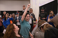 """Zursey Maya of Gentry (center) reacts after a cake diving contest, Sunday, January 26, 2020 during the Kiss the Brides Expo at the Northwest Arkansas Convention Center in Springdale. Check out nwaonline.com/200127Daily/ for today's photo gallery.<br /> (NWA Democrat-Gazette/Charlie Kaijo)<br /> <br /> The annual Kiss the Brides Expo entered its tenth year in Northwest Arkansas with 100 exhibitors, runway shows and games and contests for engaged couples. Over 1,200 people and 400 brides attended the one day event. <br /> <br /> """"The pages of a wedding magazine comes to life,"""" said Ralph Desuse, executive producer of Kiss the Brides Expo."""