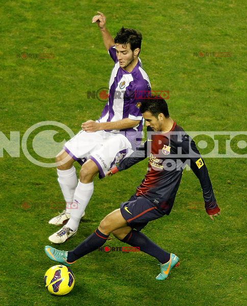 Real Valladolid's Marc Valiente (l) and FC Barcelona's Pedro Rodriguez during La Liga match.December 22,2012. (ALTERPHOTOS/Acero) /NortePhoto