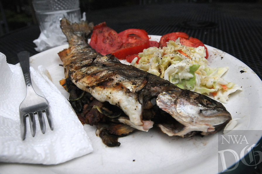NWA Democrat-Gazette/FLIP PUTTHOFF <br /> A delicious trout dinner is a fine ending    Aug. 26 2016   to a fishing trip on the White River below Beaver Dam.