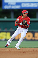 Shortstop Mauricio Dubon (10) of the Greenville Drive plays the infield in a game against the Charleston RiverDogs on Saturday, May 23, 2015, at Fluor Field at the West End in Greenville, South Carolina. Dubon is the No. 23 prospect of the Boston Red Sox, according to Baseball America. Charleston won 5-4. (Tom Priddy/Four Seam Images)