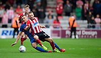 Lincoln City's Joe Morrell is fouled by Sunderland's Charlie Wyke<br /> <br /> Photographer Chris Vaughan/CameraSport<br /> <br /> The EFL Sky Bet League One - Lincoln City v Sunderland - Saturday 5th October 2019 - Sincil Bank - Lincoln<br /> <br /> World Copyright © 2019 CameraSport. All rights reserved. 43 Linden Ave. Countesthorpe. Leicester. England. LE8 5PG - Tel: +44 (0) 116 277 4147 - admin@camerasport.com - www.camerasport.com