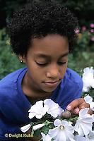 1Y08-089z   Land Snail - girl finding snail on flower