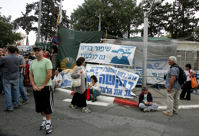 Friends and supporters of Noam and Aviva Shalit, parents of abducted Israeli soldier Gilad Shalit who was captured in 2006 by Hamas-allied militants in the Gaza Strip, gather at the family's protest tent on the 1,935th day for their son's captivity outside Prime Minister Benjamin Netanyahu's residence in Jerusalem on October 12, 2011. Israelis welcomed on Wednesday a major prisoner swap that will free soldier Gilad Shalit after five years in captivity in return for the release of 1,000 Palestinians, but emotions were mixed over the lopsided exchange negotiated with Hamas. Photo by Mahfouz Abu Turk