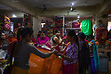 India - Manipur - Imphal - Clients take a look at textiles sold at the Ima Market.
