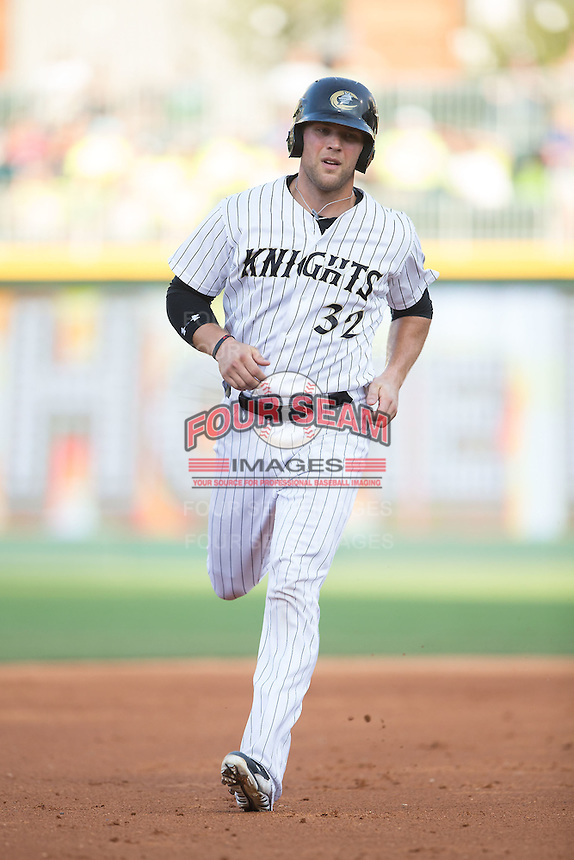 Kevan Smith (32) of the Charlotte Knights rounds the bases during the game against the Indianapolis Indians at BB&T BallPark on June 20, 2015 in Charlotte, North Carolina.  The Knights defeated the Indians 6-5 in 12 innings.  (Brian Westerholt/Four Seam Images)