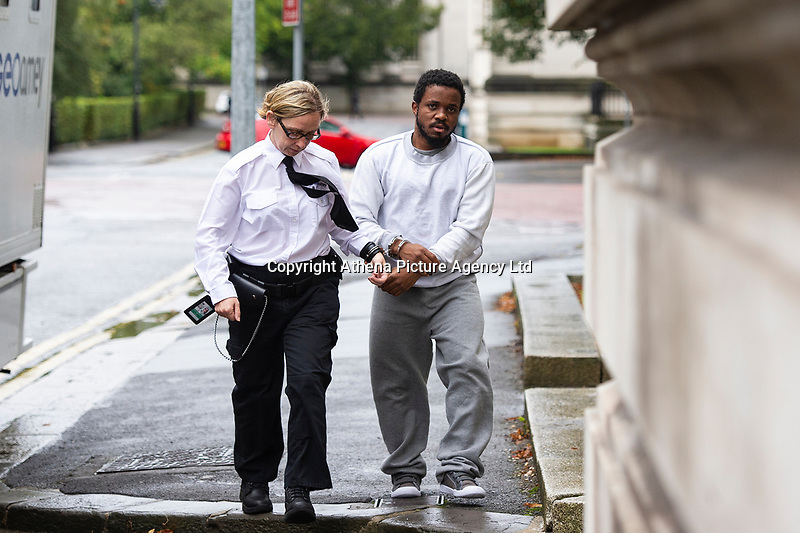 """Pictured: Peter Shodeinde (R) arrives at Cardiff Crown Court, Cardiff, Wales, UK. Friday 27 September 2019<br /> Re: Two men who handcuffed another to a radiator for over 24hrs have are due to be sentenced by Cardiff Crown Court, Wales, UK.<br /> Peter Shodeinde and Sochi Ezeemo, both 27, collected the man from Bristol and brought him to a house in Treforest. <br /> Ezeemo contacted the brother of the victim in Nigeria demanding money they said was owed to them. Police in the UK were contacted by the victim's brother telling them about the demands. <br /> When police raided the house where they believed the victim was being held prisoner, they found him injured and handcuffed to a radiator.  <br /> Shodeinde claimed that he was part not of the kidnapping and false imprisonment but evidence presented by the CPS was able to prove that he was. <br /> Kelly Huggins, of the CPS, said: """"The victim suffered appalling treatment whilst being kept prisoner, being beaten, deprived of sleep and enduring acts of humiliation such as shaving off his hair.<br /> """"It is difficult to imagine how frightening this horrible experience would have been for the victim.<br /> """"Now that the case has concluded, we hope it will help him move forward in his healing process."""""""