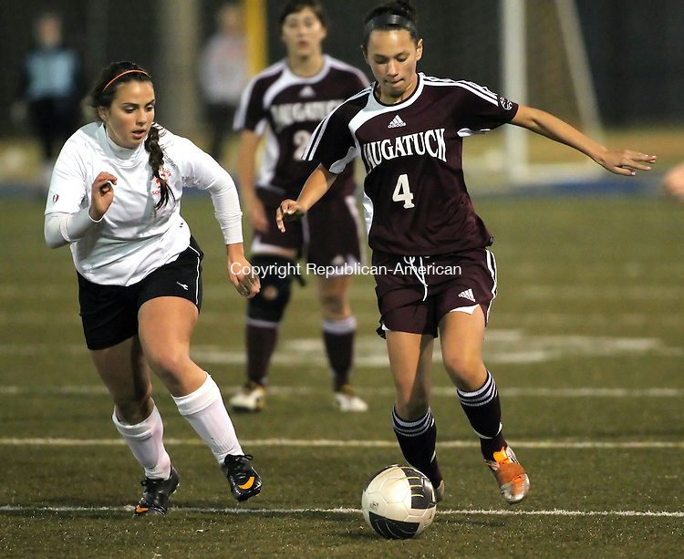 Waterbury, CT-08 November 2011-110811CM07-  Watertown's Erica Daley (left) sprints in to defend Naugatuck's Alexya Alves as she carries the ball during the girls NVL soccer finals Tuesday night a Municipal Stadium in Waterbury.     Christopher Massa Republican-American