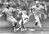 Montreal Expo's Gary Carter is forced out at 2nd by Blue Jays Alfredo Griffin and Jays Damaso Garcia..during the 1984 MLB All-Star game in S.F. <br />
