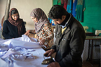 Clothes making workshop for young people at the Afghan Action NGO building in Kabul, Afghanistan 6-1-14