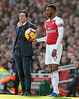 Arsenal manager Unai Emery looks on as Ainsley Maitland-Niles waits to take a throw in<br /> <br /> Photographer David Shipman/CameraSport<br /> <br /> The Premier League - Arsenal v Burnley - Saturday 22nd December 2018 - The Emirates - London<br /> <br /> World Copyright © 2018 CameraSport. All rights reserved. 43 Linden Ave. Countesthorpe. Leicester. England. LE8 5PG - Tel: +44 (0) 116 277 4147 - admin@camerasport.com - www.camerasport.com