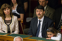 Janos Ader (2nd R) sits among members of his family before he takes the oath of office as the new President of Hungary in Budapest, Hungary on May 02, 2012. ATTILA VOLGYI