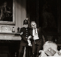 """Mr Posket (Nigel Hawthorne) and Sgt Lugg (Michael Beint) in """"The Magistrate"""" by Arthur Wing Pinero, directed by Michael Rudman, designed by Carl Toms, National Theatre, London, 1986."""
