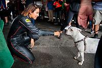 Sep 13, 2019; Mohnton, PA, USA; NHRA pro stock motorcycle rider Jianna Salinas greets a dog during qualifying for the Keystone Nationals at Maple Grove Raceway. Mandatory Credit: Mark J. Rebilas-USA TODAY Sports