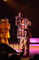 July 12 2002, Montreal, Quebec, Canada<br /> <br /> FEMI KUTI & the Positive Force, from Nigeria, plays the Spectrum, in Montreal, Canada, July 12, 2002 during the Nuits d'afrique Festival.<br /> <br /> The princely son of indomitable Fela is now an Afrobeat king in his own right. Traditional Yoruba rhythms and melodies are married to funk and jazz, soul, salsa and hip hop. Femi's latest release is aptly titled Fight To Win.<br /> <br /> Mandatory Credit: Photo by Pierre Roussel- Images Distribution. (©) Copyright 2002 by Pierre Roussel <br /> <br /> NOTE : <br />  Nikon D-1 jpeg opened with Qimage icc profile, saved in Adobe 1998 RGB<br /> .Uncompressed  Uncropped  Original  size  file availble on request.
