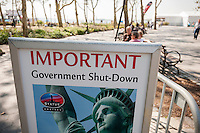 A sign in Battery Park  in New York where ferries to the Statue of Liberty launch informs tourists that the statue is closed, seen on Tuesday, October 1, 2013. A partial government shutdown took effect today because of a dispute between Democrats and Republicans in Congress over the Obamacare program. Approximately 800,000 federal workers have been furloughed and only essential services are up and running.  © Richard B. Levine)