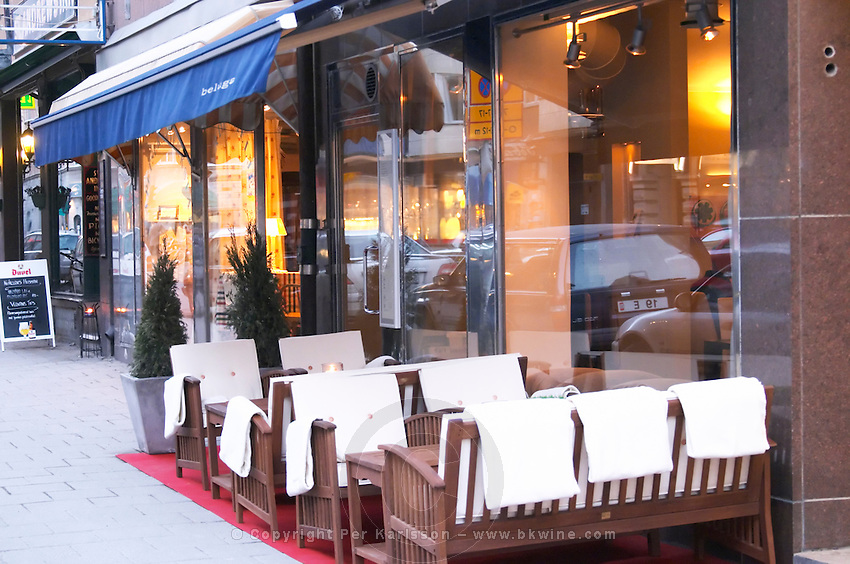 The outside seating at the trendy restaurant Beluga on Ostermalm. Park benches with warming fleece blankets Stockholm, Sweden, Sverige, Europe