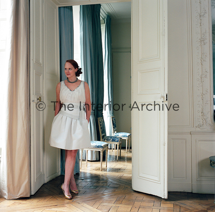 Anne Grauso standing in the living room of her Paris apartment